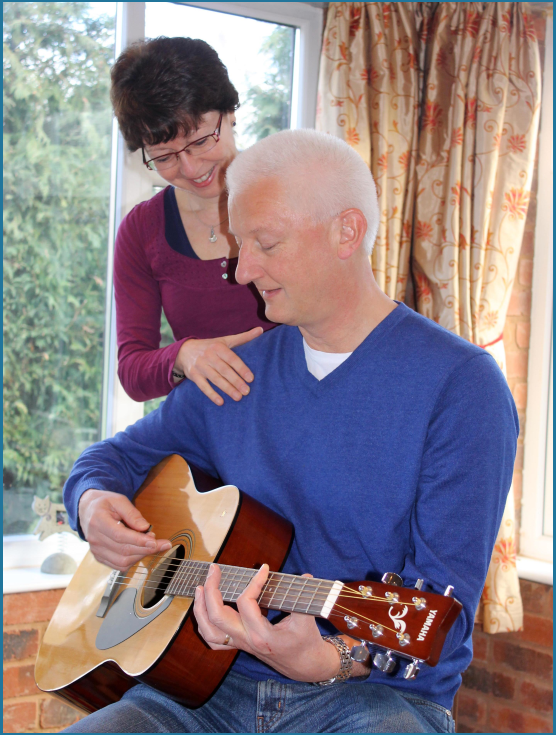 Jane teaching a guitar player (what happens in a lesson page)