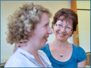 close-up photo of Jane teaching individual